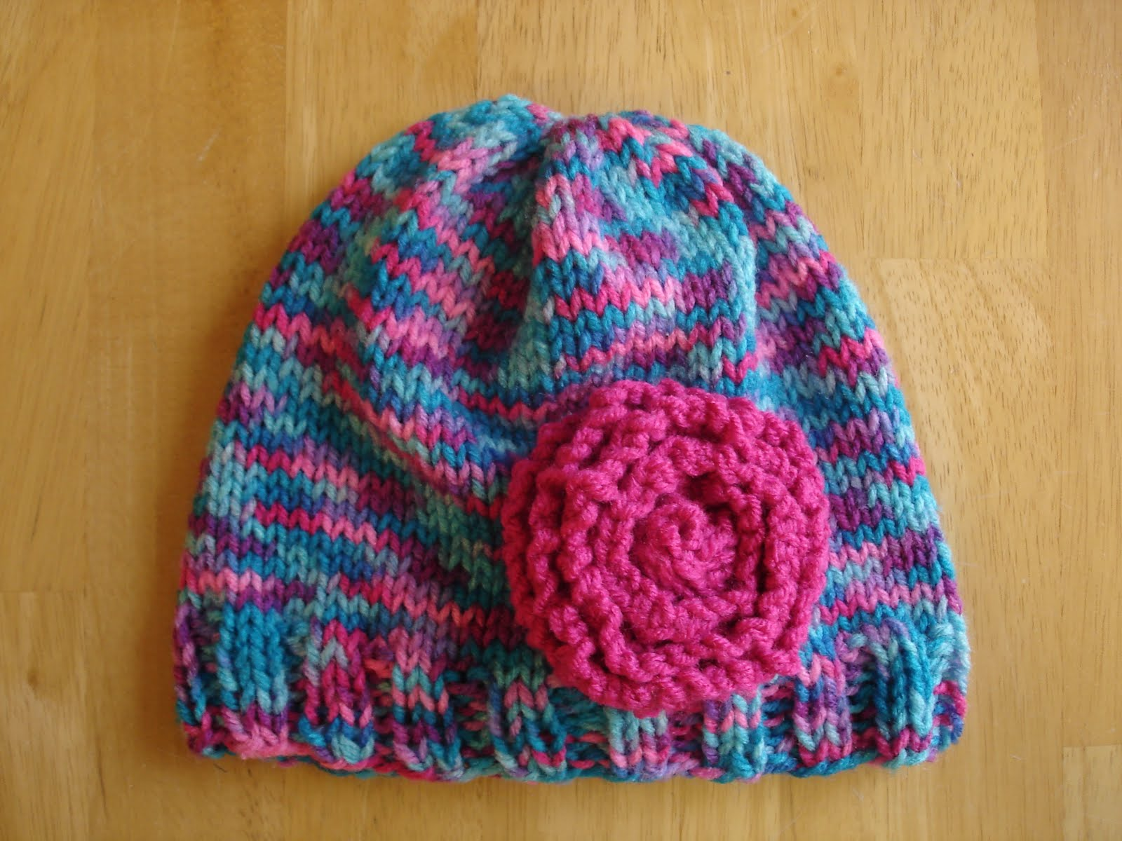 Free Knitting Pattern Baby Flower Hat : Fiber Flux: 10 Great Kids Hats to Knit for Charity