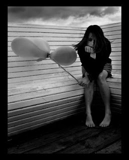 lonely girl with balloons