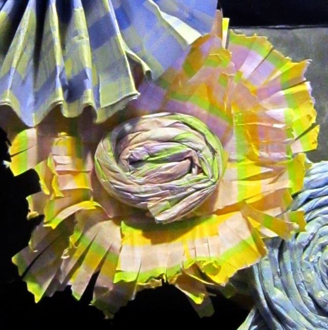 Yellow paper petal flower with a coiled center.