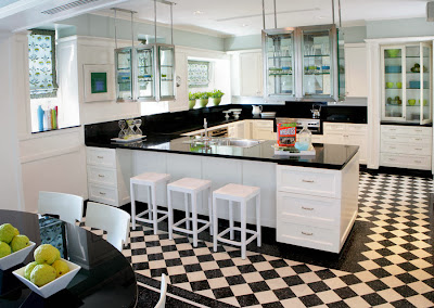 modern black and white kitchen with checkerboard floor