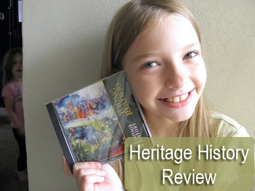 little girl holding history CD