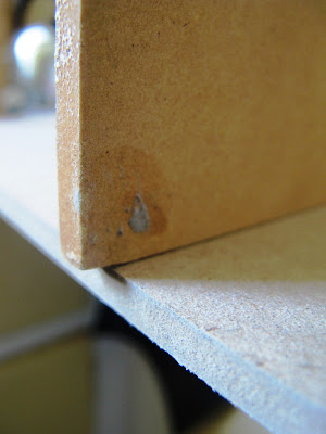 One piece of MDF, perpendicular to another, with a small amount of overhang.