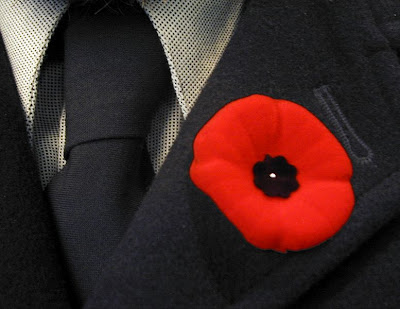 Lest we forget - picture of Canadian remembrance poppy, by user striatic at Flickr.com - Released under Creative Commons Attribution-Share Alike 2.0 Generic license.