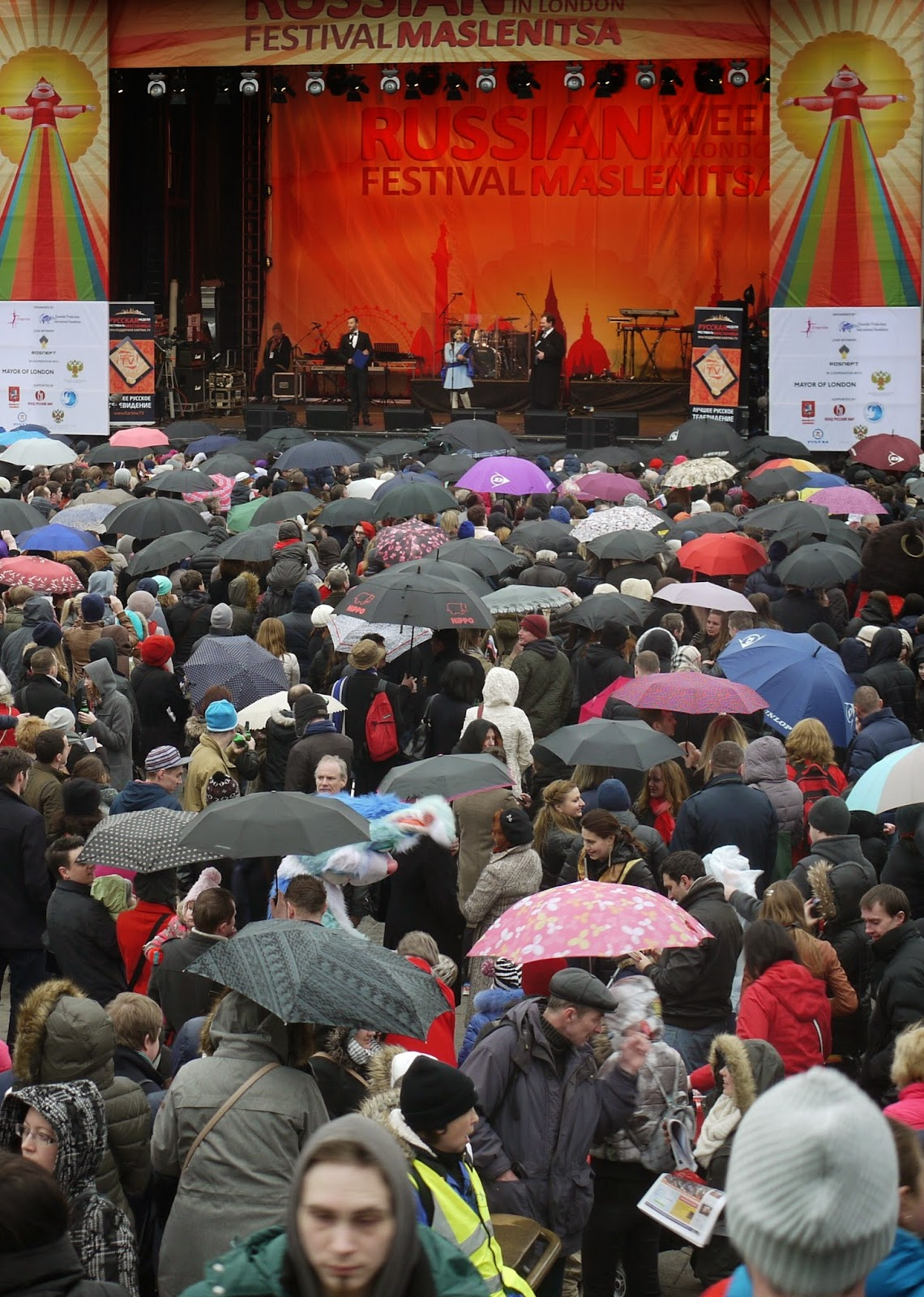 Rain and politics did not keep the crowds of Russian away from Trafalgar Square for Sunday's sixth Maslenitsa festival