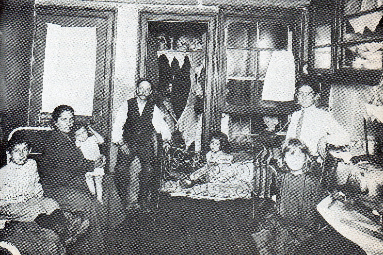 and Sicilian immigrants lived in the poortenement slums of Brooklyn title=