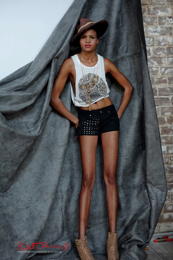 Full length, 'Grace Jones' style shot, canvas and brick background.