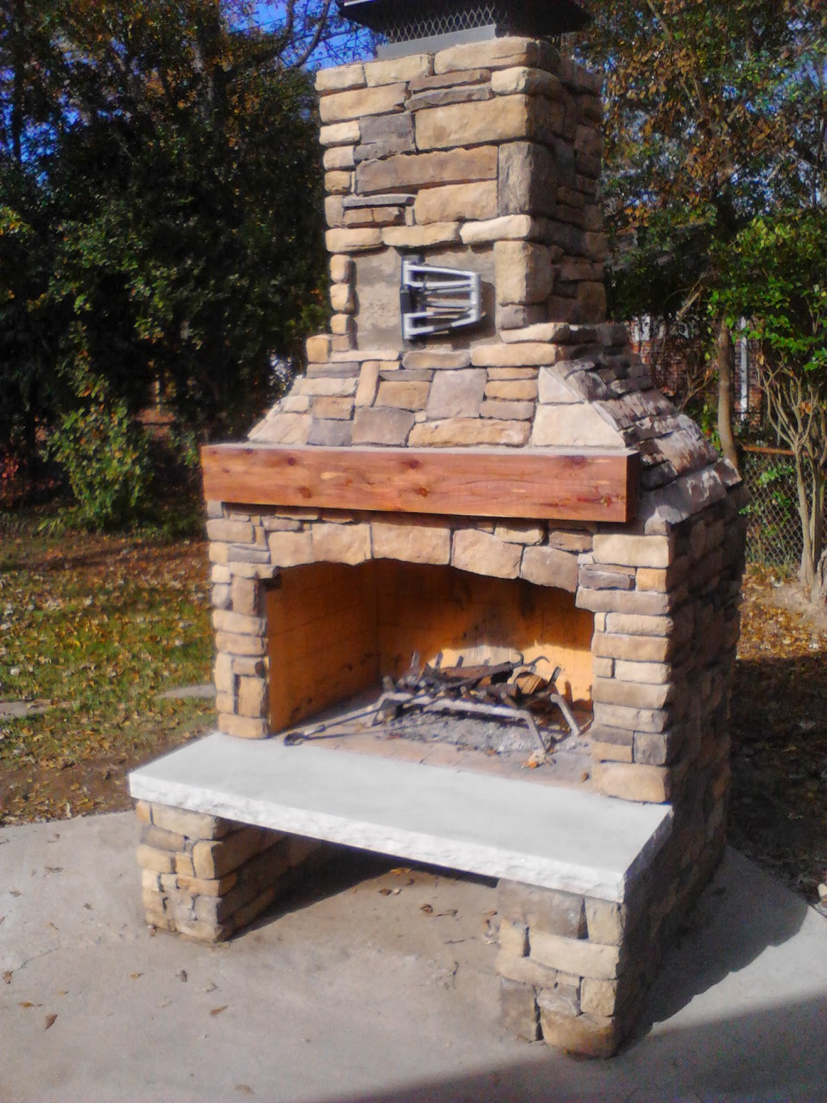 greetings from earth outdoor fireplace using veneer cast stone