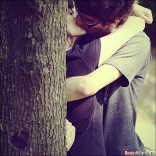 lip lock kiss between couple with tree