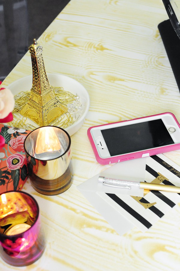 This DIY gold faux bois desk styled with pink and gold accents looks glam in Monica's home office. Tutorial and details available at monicawantsit.com