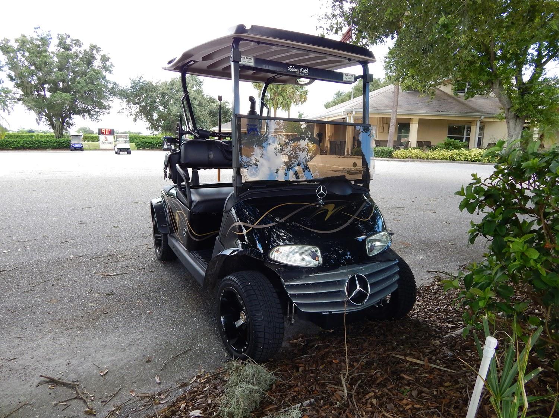 Homemade black Mercedes-Benz EZ-GO golf cart, Sun City Center, FL on maserati golf cart, harley davidson golf cart, 8 seater golf cart, ferrari golf cart, ducati golf cart, hummer golf cart, convert to gas golf cart, lamborghini golf cart, john deere golf cart, yanmar golf cart, ac golf cart, dodge ram golf cart, camaro golf cart, audi golf cart, custom golf cart, ford think golf cart, d&d golf cart, bentley golf cart, big rig golf cart, cadillac golf cart,