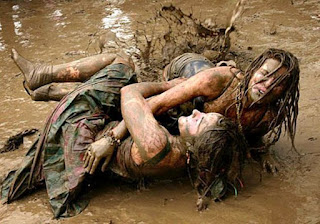 Girls mud wrestling fighting hair pulling