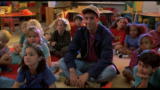 Adam Sandler sitting with students as seen in the movie Billy Madison