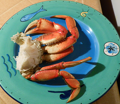 Half crab on plate, ready to eat