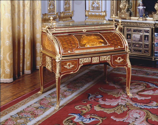 Desk  attributed to Jean-Henri Riesener, c. 1775-80,   Oak, purplewood, mahogany, casuarina wood, holly, boxwood and sycamore, with gilt bronze mounts. Purchased by George IV at the George Watson Taylor sale, on 1825 for £107.  Royal Collection , UK