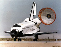 Space Shuttle orbiter landing on runway