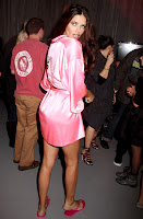 Adriana Lima in a pink robe backstage