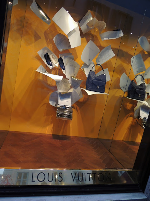 Louis Vuitton window display with typewriter and accessories.