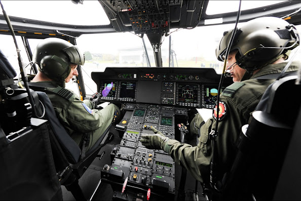 Belgium's King Philippe is pictured at the command of a NH90 helicopter during a visit to the Beauvechain Air Base