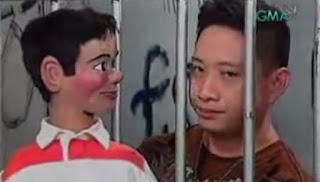Bitoy talking to his puppet inside the cell.