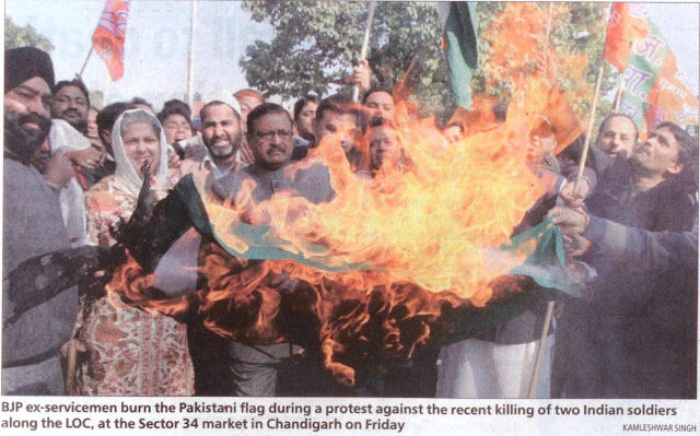 BJP leader Satya Pal Jain and BJP ex-servicemen burn the Pakistani flag during a protest against the recent killing of two Indian soldiers along the LOC, at the Sector 34 market in Chandigarh on Friday.