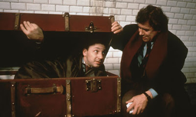 Zbigniew Zamachowski as Karol Karol (with his Pole friend Mikoaj), hides in the suitcase, Three Colors: White, Directed by Krzysztof Kieslowski