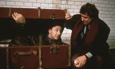 Zbigniew Zamachowski as Karol Karol (with his Pole friend Mikoaj), hides in the suitcase, Three Colors: White, Directed by Krzysztof Kieslowski