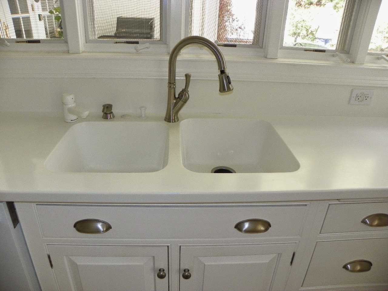 The solid surface and stone countertop repair blog retro for Corian farm sink price
