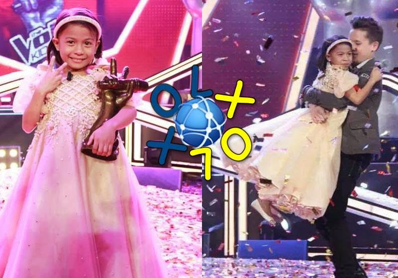 Lyca holding her TVK trophy. She was carried by one of her competitors, Juan Karlos.