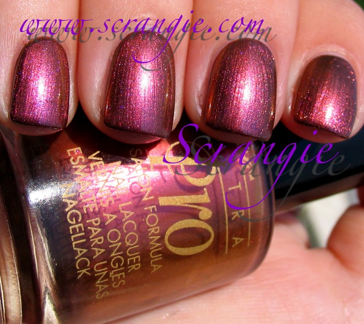 Scrangie: Nina Ultra Pro Molten Gold over OPI Suzi Says Da!