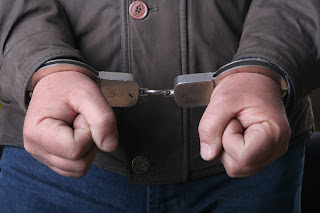 Man's fist in handcuffs