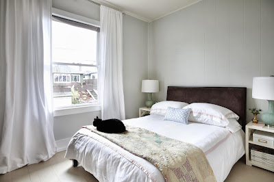 white elegant bedroom with sweet brown on the bed as attractive visual