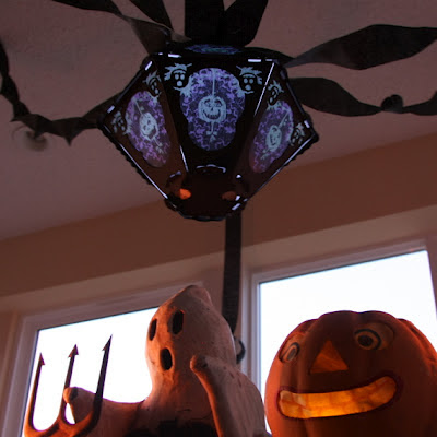 Vintage Halloween German Pumpkin with vintage-style decorations of a ghost by Hobgoblin and a lantern by Bindlegrim