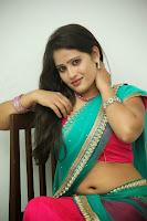 Anusha sizzling Pictures in half saree 063.JPG