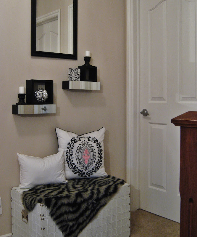 Our small, second floor bedroom landing features a white leather chest  title=