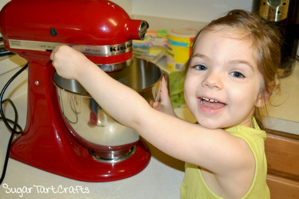 "Aurelia helping me bake the ""Sweet"" 16 cake"