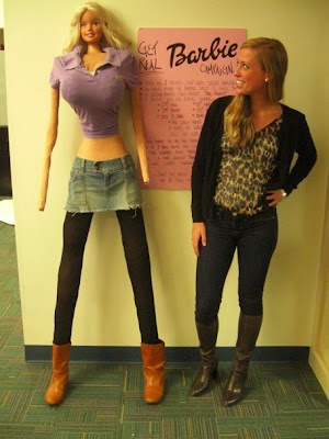 Normal/thin young woman standing next to a disturbingly proportioned homemade mannequin