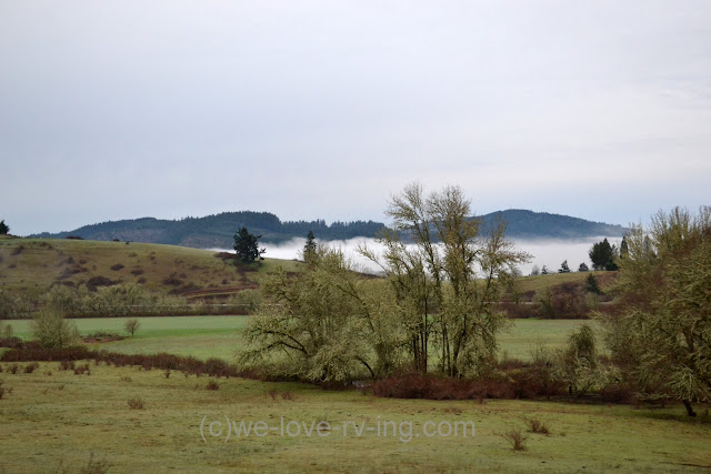 A patch of fog sits in a valley in the distance