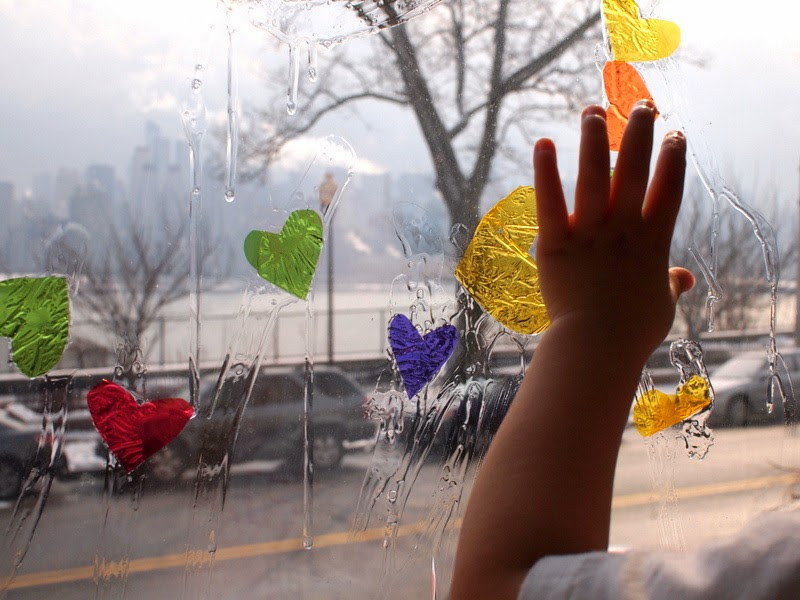 stick your cellophane pieces to the window with dish soap