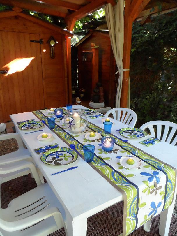 Centro de mesa veraniego con una pecera y conchas car - Centros de mesa con peceras ...