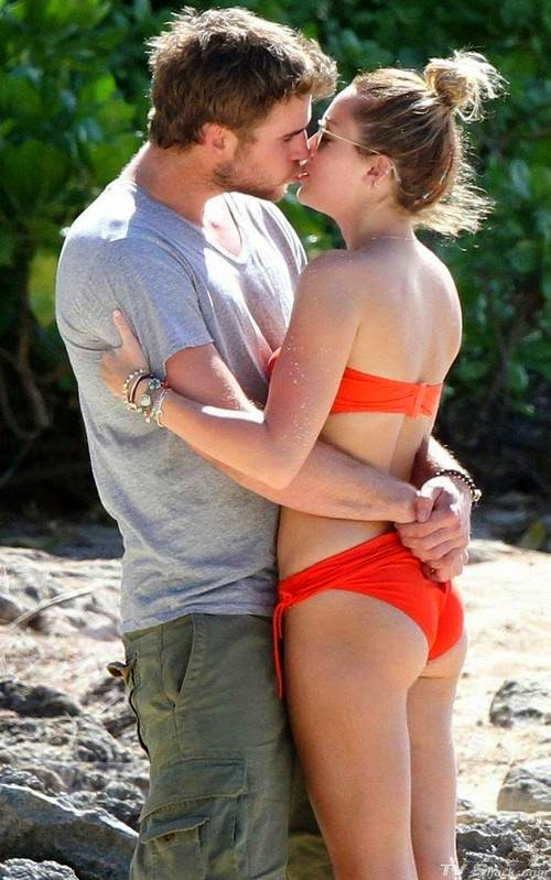 Miley Cyrus Hannah Montana actor is famous. It turns out Miley Cyrus likes to buy bikini Victoria Secret products. Here is Miley Cyrus bikini red, use that time was kissing my beloved boyfriend with lovey-dovey. After that go to the bathroom alone, this incident is on the famous beach of Hawaii. only Miley Cyrus and boyfriend who knows what they are doing next.