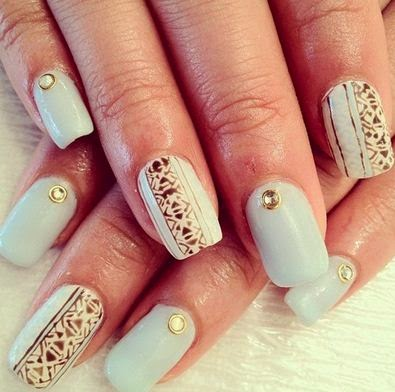 White nails with decorations