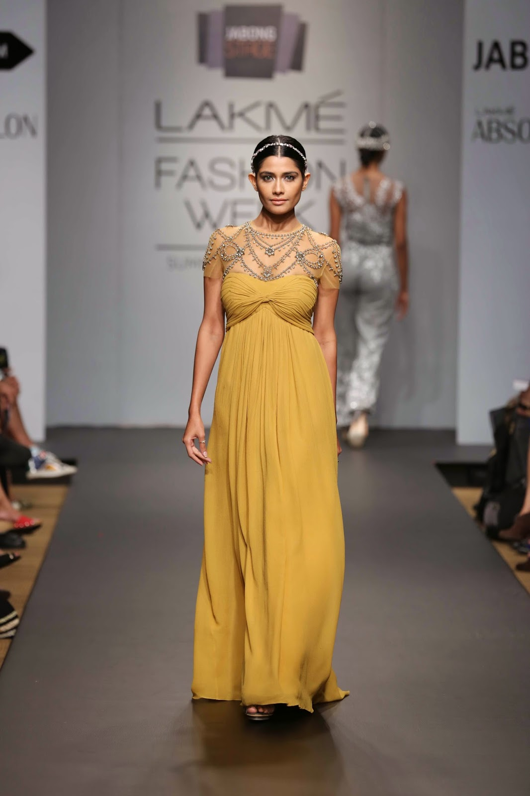 dresses, gowns, kaftans, pantsuits, skirts and pants in rich colours inspired by various Indian spices such as mustard, paprika, rye and bay leaves.