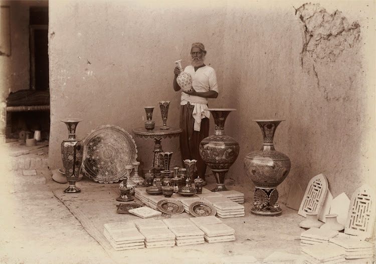 A Potter from Hala near Moro in Sindh with examples of Hala Pottery - 1896