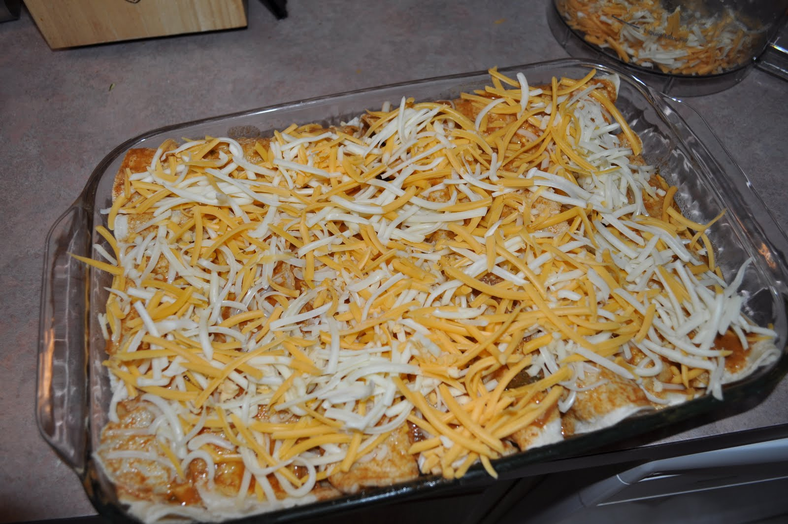 Assemble the enchiladas with meat, cheese and more chopped cilantro ...