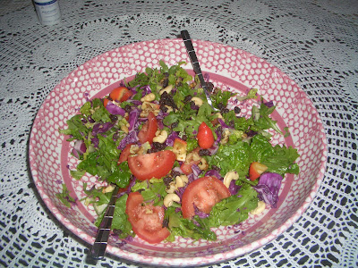 arugula, tomatoes, red cabbage and raw cashews