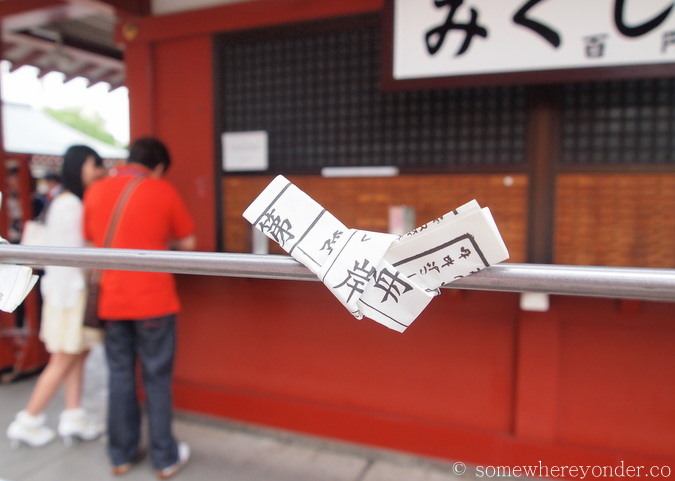 Discarding a bad fortune in Asakusa, Japan