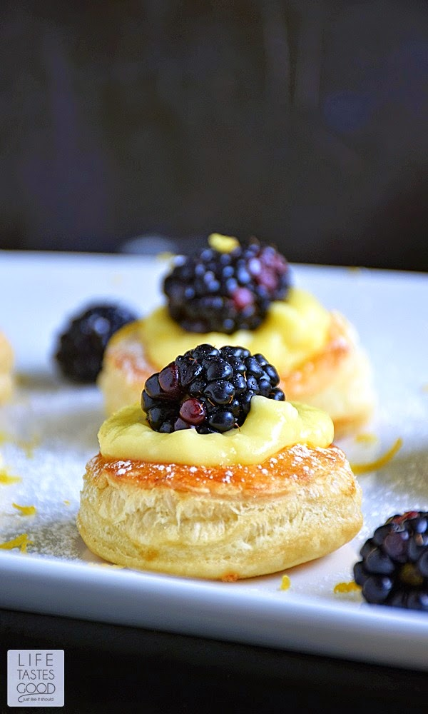 Lemon Blackberry Mini Tarts | by Life Tastes Good make an impressive dessert perfect for special occasions, such as Mother's Day. The cutest little pastry puff encases my incredibly easy-to-make Luscious Lemon Curd topped off with a sweet and juicy blackberry. This dessert is sure to brighten your day with the fresh citrus flavors, and you won't believe how easy this gorgeous dessert is to make!