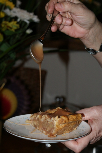 Drizzling caramel over a slice