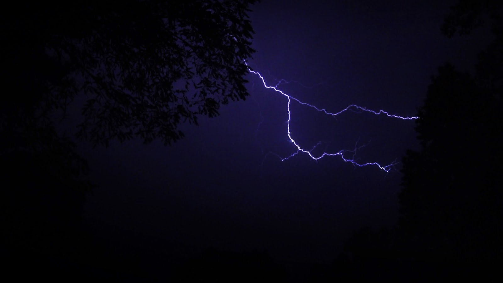 A brief still of a longer and available stock footage clip of a lightning storm.