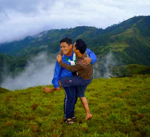 Two mountaineers romantically playing at Mt. Ugo hover_share